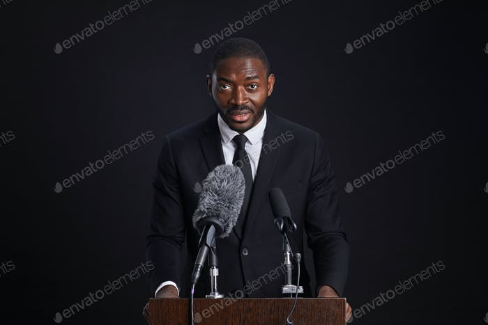 Confident African-American Speaker at Podium