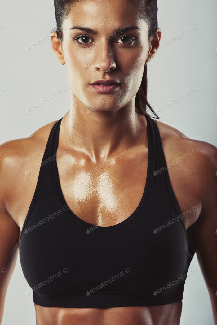 Attractive female bodybuilder posing confidently