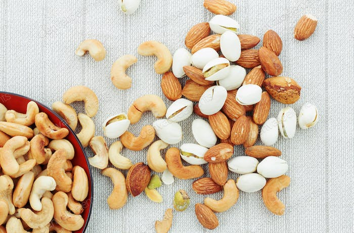 cashew nut and almonds on tablecloth