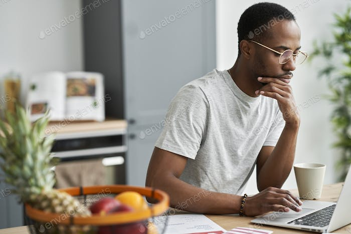 Pensive man focused on searching information about election