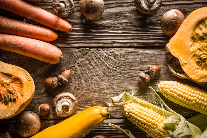 Frame of vegetables and mushrooms on wooden boards