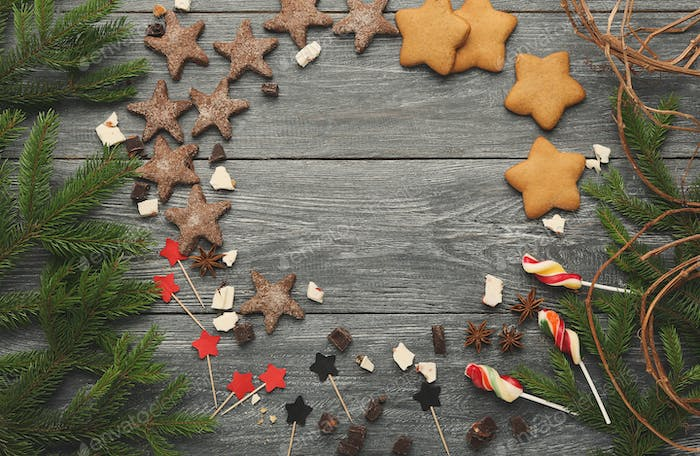 Christmas sweets and pine tree branches background, mockup