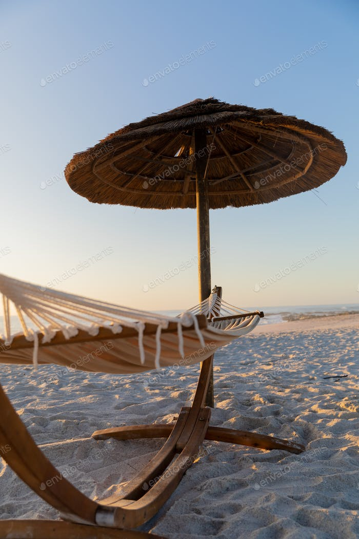 Magnificent of a hammock and an umbrella standing on a beach