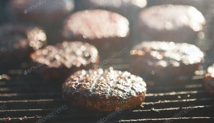 Cooking Delicious Juicy Meat Burgers On Grill Outdoors