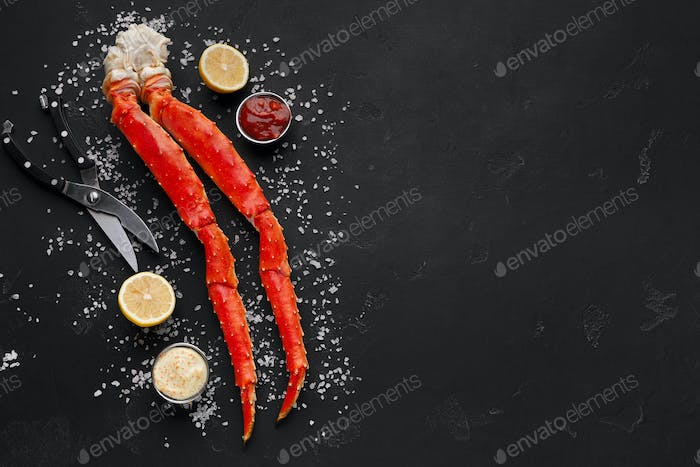 Delicious king crab legs with eating tools top view