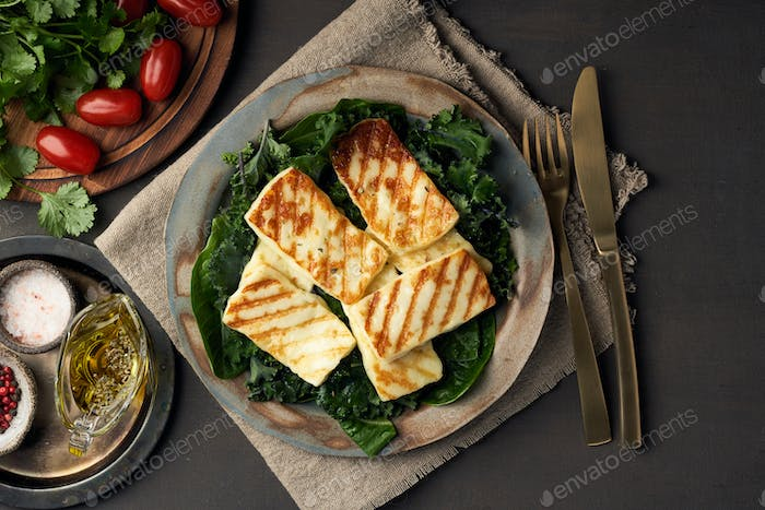 Cyprus fried halloumi cheese with healthy green salad. Lchf, pegan, fodmap, paleo, scd, keto diet.