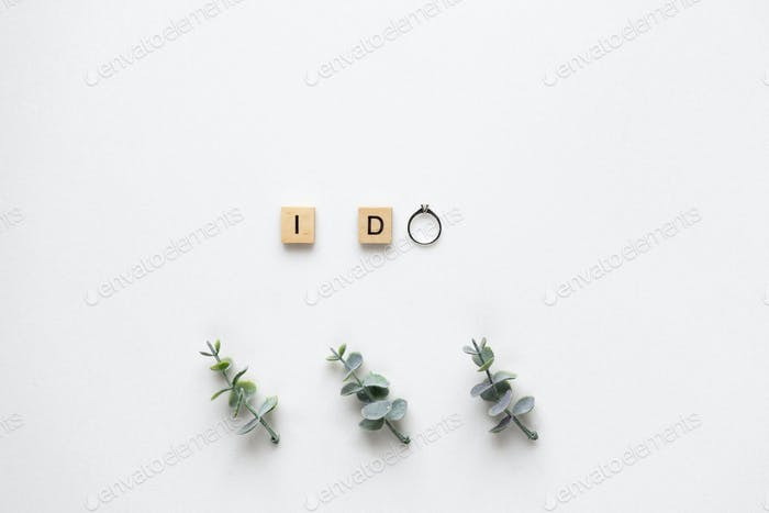 Wooden letters  spelling I do with engagement ring, oregano bran