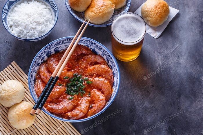 Bowl of shrimps with chopsticks, rice and beer, copyspace