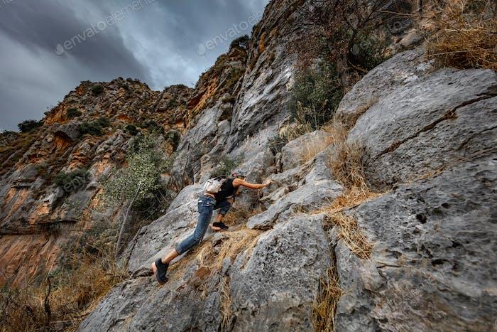 Woman Climbing the Cliffs