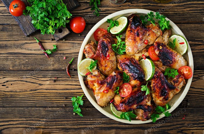 Chicken wings of barbecue in sweetly sour sauce. Picnic. Summer menu. Tasty food. Top view. Flat lay