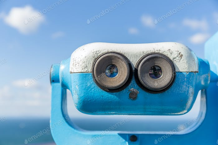 Coin operated binocular viewer with blue sky