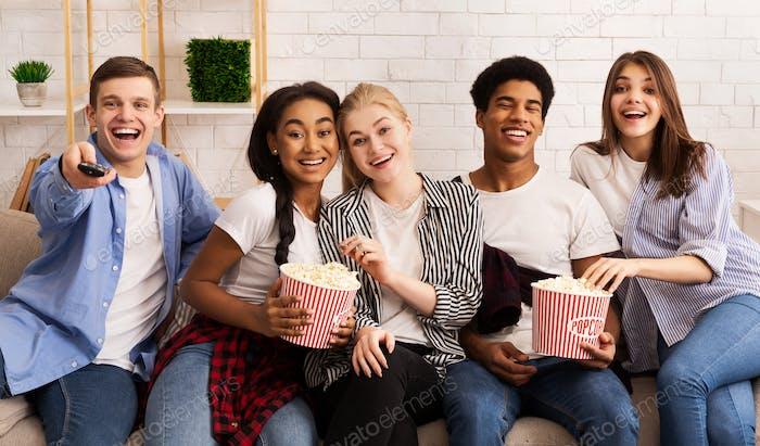 Teen friends spending weekend together, watching films