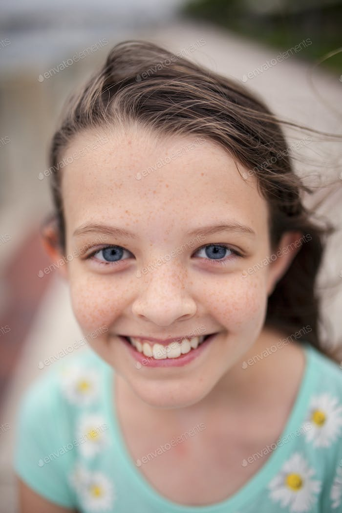 beautiful little girl with blue eyes and freckles