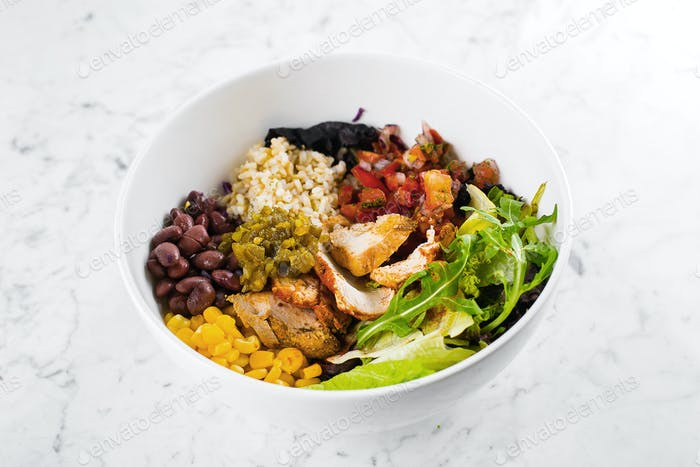 Mexican Lunch bowl on marble background.