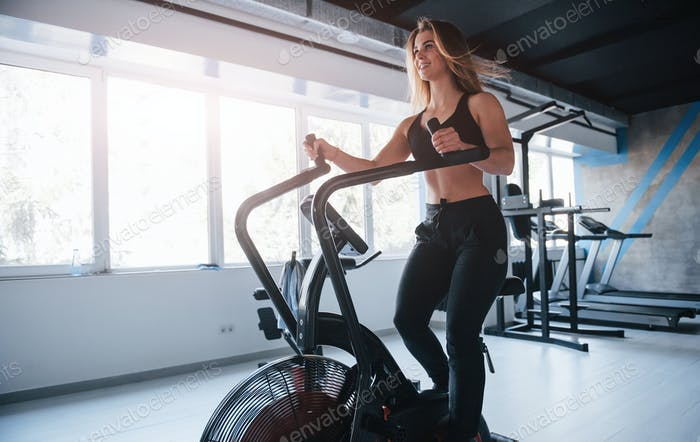 Full length photo. Photo of gorgeous blonde woman in the gym at her weekend time
