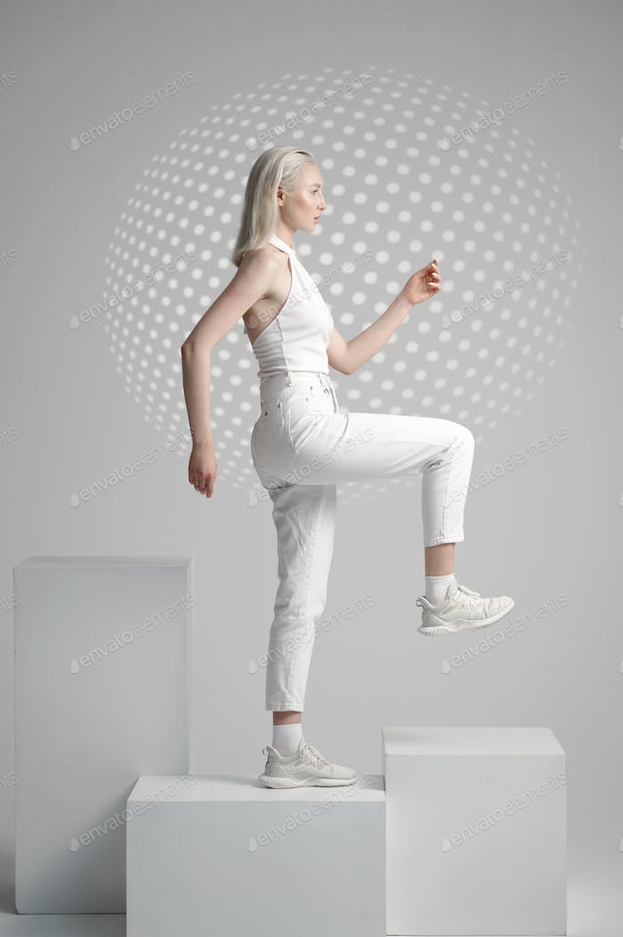 Futuristic young woman stands on cube, futurism