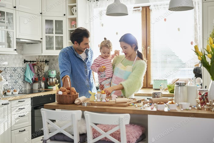 Happy family spending Easter together in the kitchen