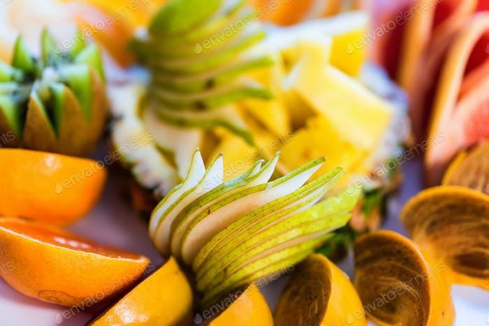 Beautiful fruit plate on festive table close up