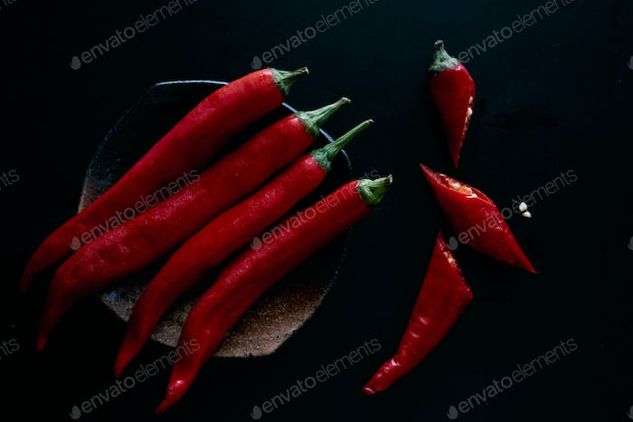Red chili peppers on black background