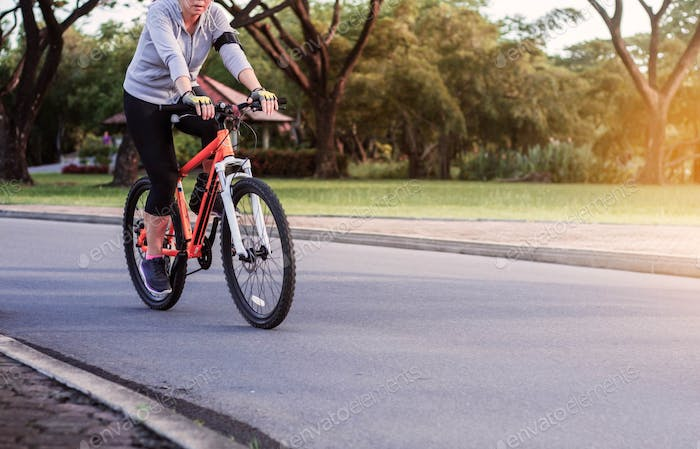 Women are cycling in park