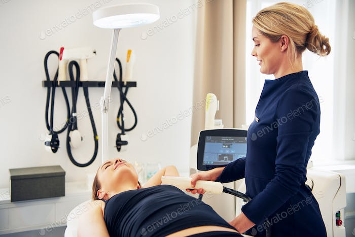 Woman having an electrolysis treatment performed on her underarm