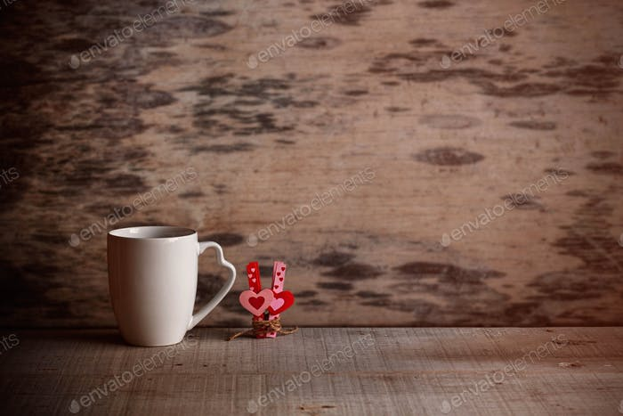 Cup and hearts on old wood