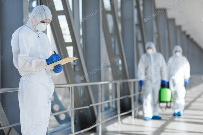 Virologists in protective hazmat suits controlling epidemic