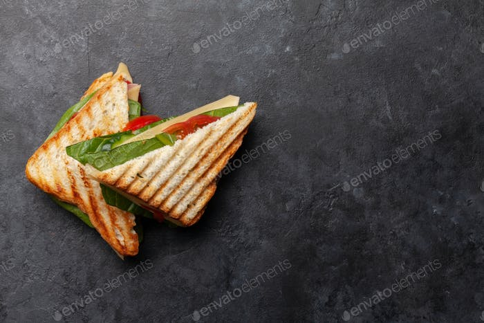 Club sandwich with ham, cheese, salad and vegetables