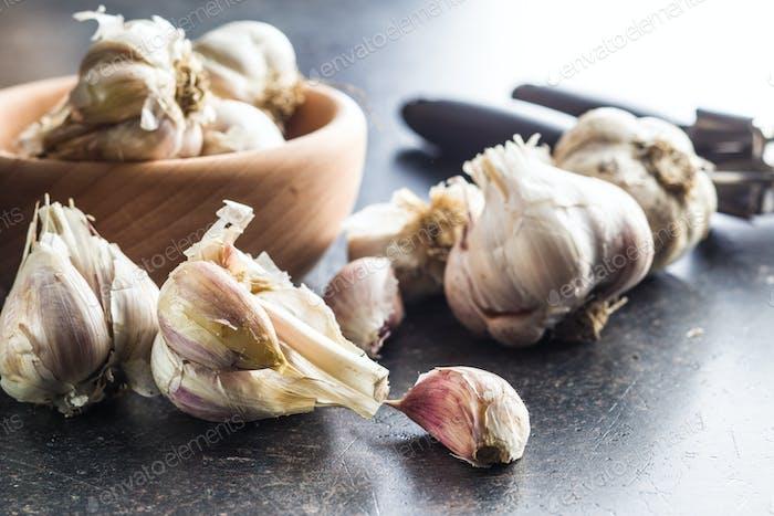 Fresh garlic and garlic presser.