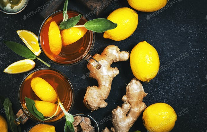Healing black herbal tea with ginger, honey, lemon and sage