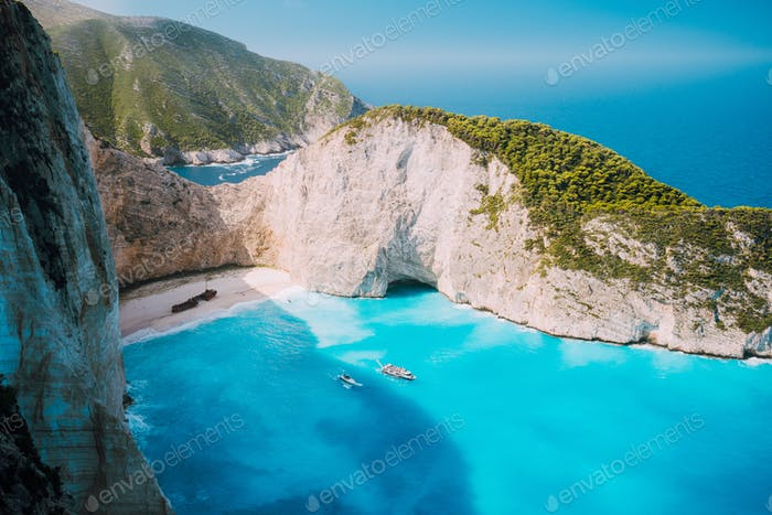 Navagio beach, Zakynthos island, Greece. Two tourist boats leaving Shipwreck bay with turquoise