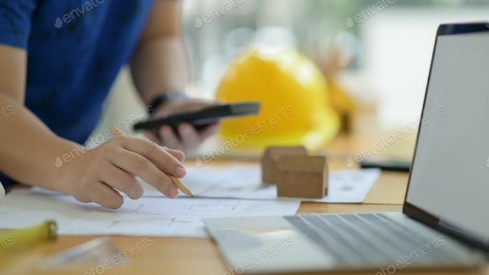 Designer is calculating and editing the house plan to present the client.