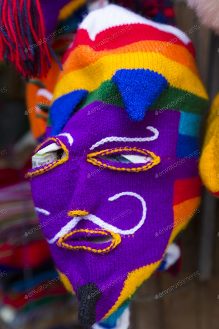 Colored woolen mask for sale at the market in Cusco, Peru