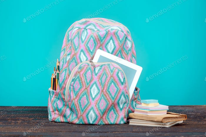 Back to School concept. Books, colored pencils and backpack