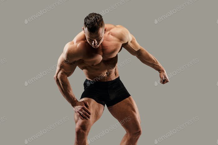 Bodybuilder posing in studio