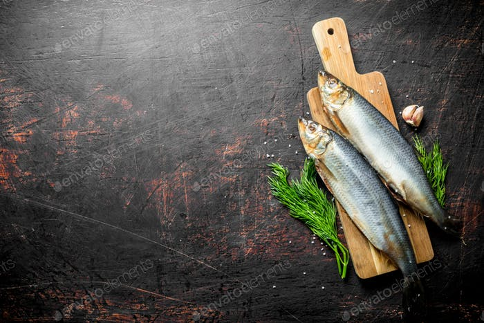 Salted herring with garlic cloves and dill.