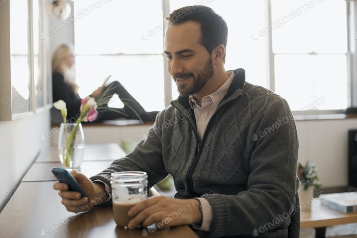 Couple Relaxing at Home with Laptop and E-Reader