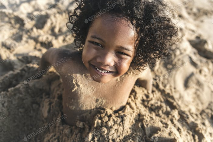 A little boy playing in the sand