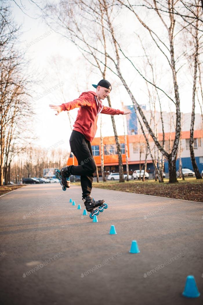Roller skater legs in skates on asphalt walkway