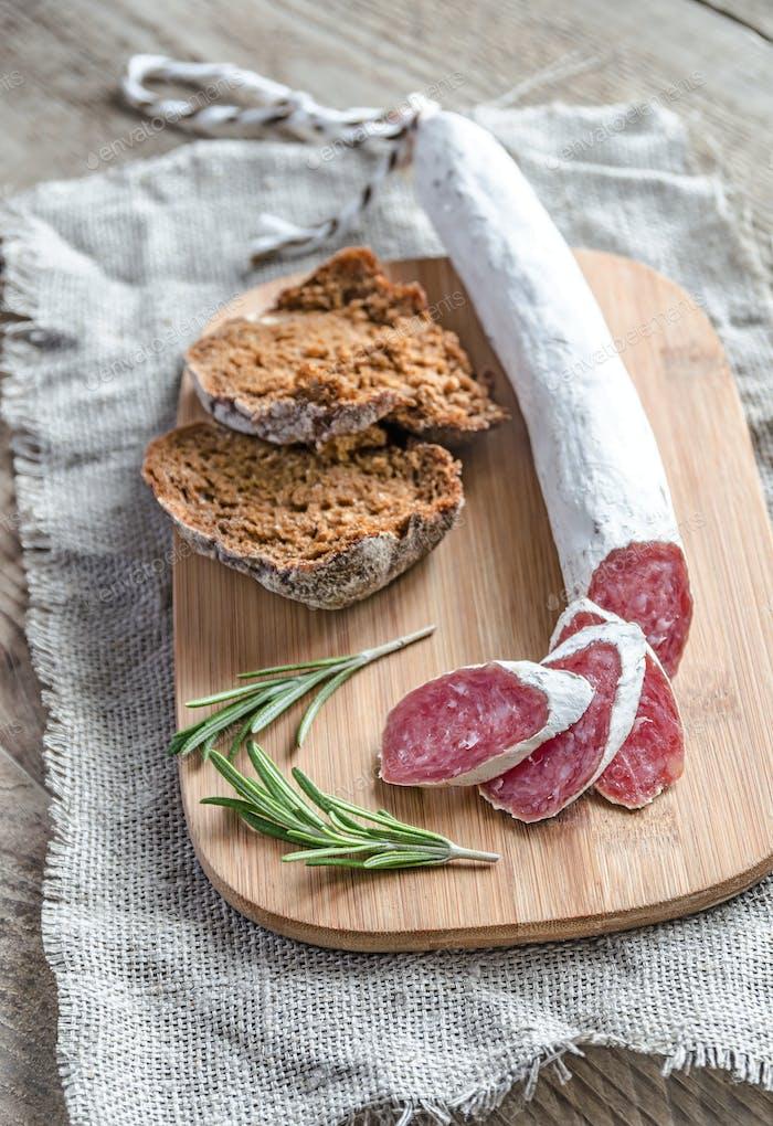 Slices of spanish salami on the sackcloth