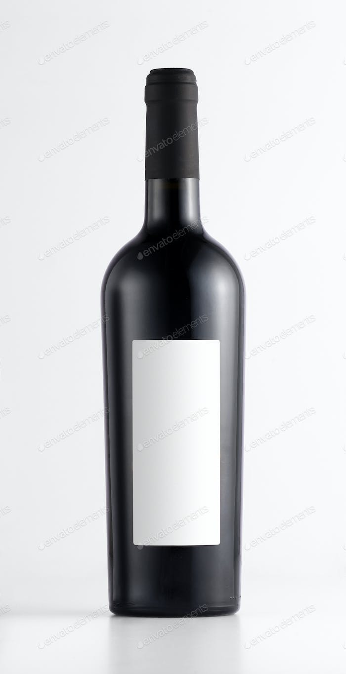 Close-up of a red wine bottle with blank label