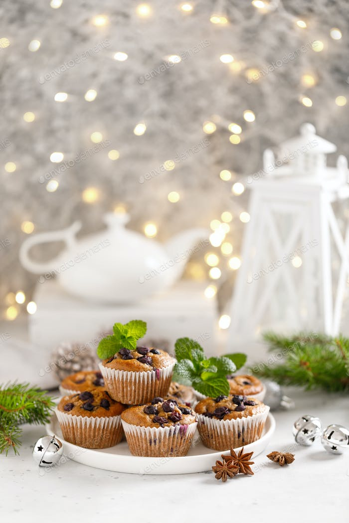 Blueberry muffins with fresh berries and Christmas, Xmas or New Year decorations