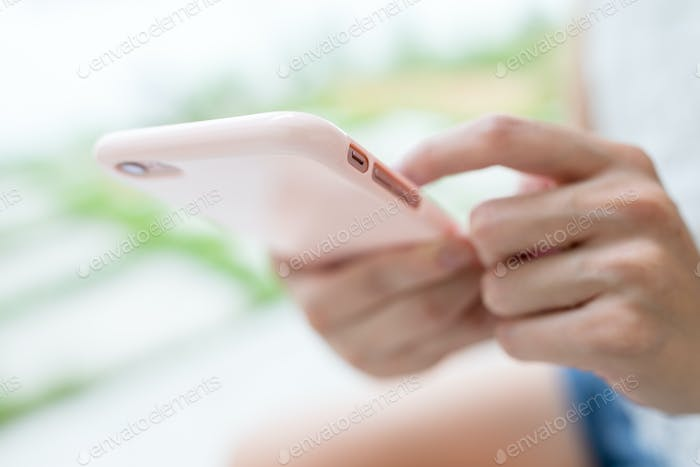 Woman use of phone for browsing internet