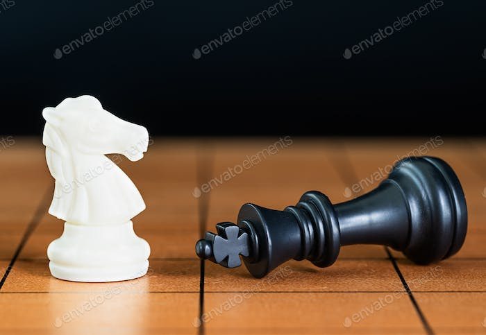 Chess pieces on a wood chessboard-4