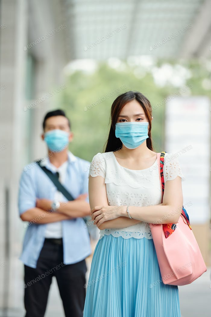 Vietnamese woman with medical mask on face