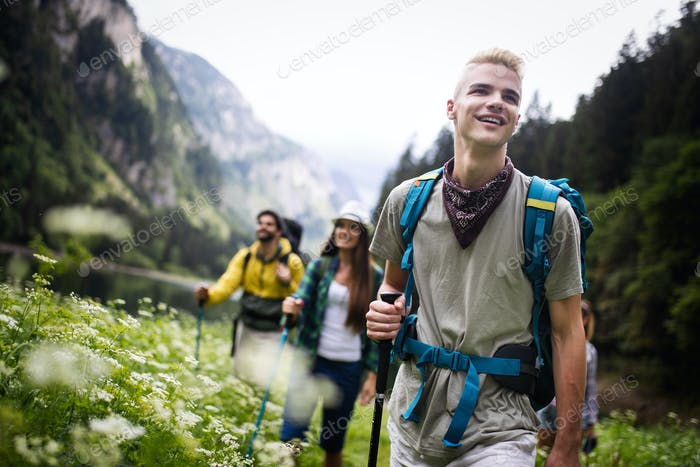 Hiking with friends is so fun. Group of young people with backpacks hiking together