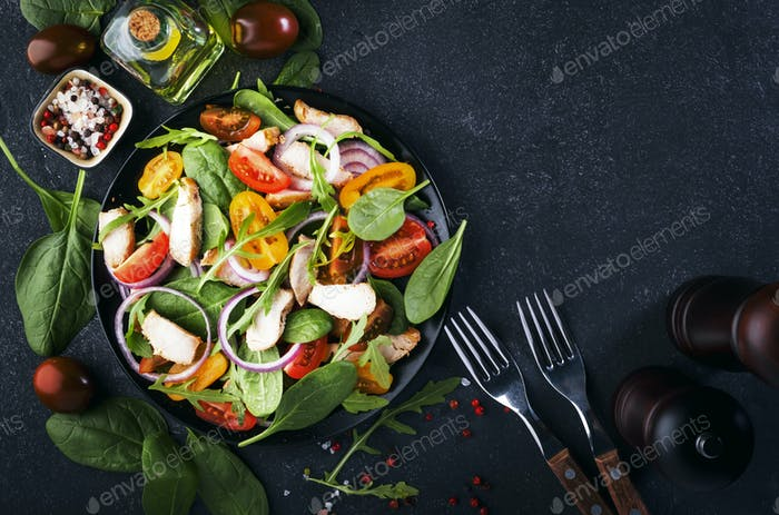 salad with spinach, grilled chicken, cherry tomatoes