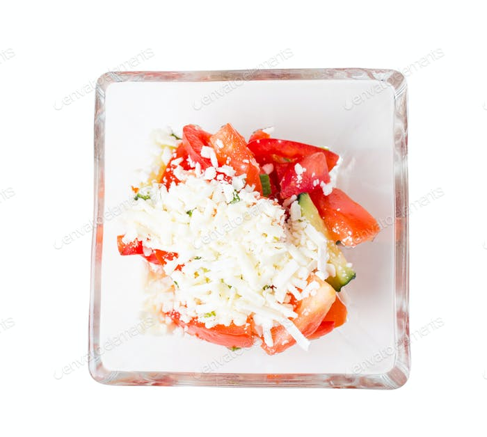 Tomato salad with feta cheese and cucumbers.