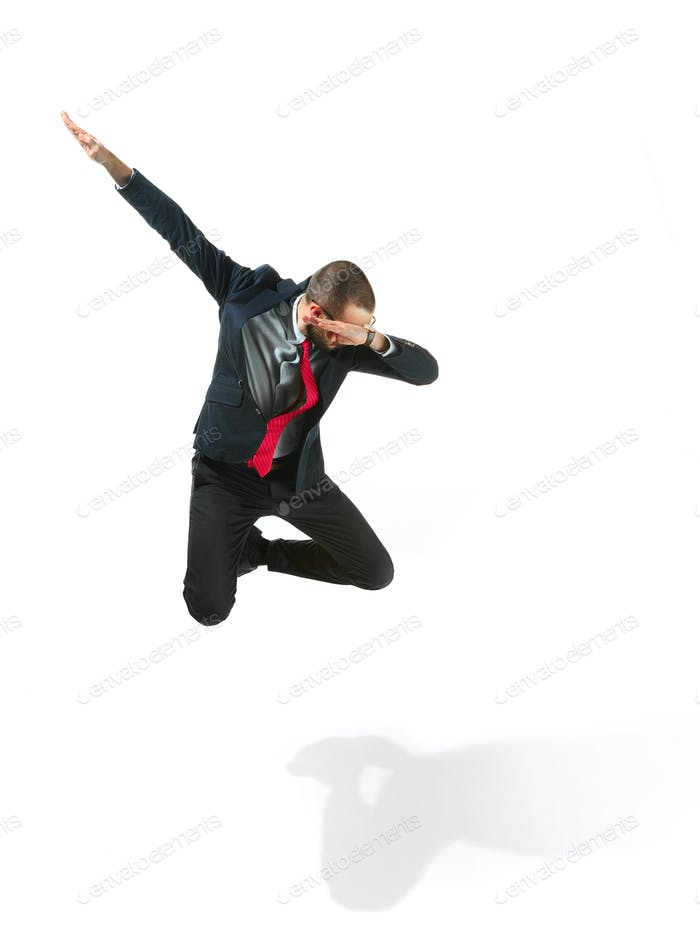 Funny cheerful businessman jumping in air over white background