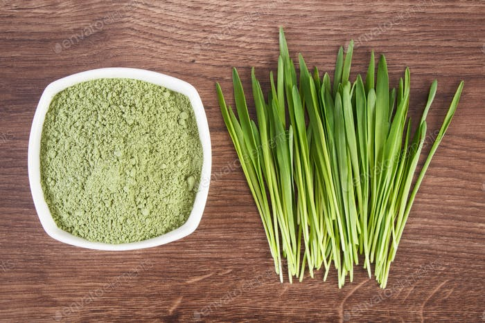 Barley grass and heap of young powder barley, body detox